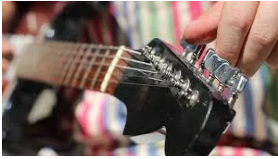 How To Tune Your Guitar And Play Your Very First Chords