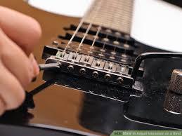 adjusting guitar string intonation