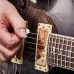 Down picking guitar